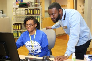 Raymona and Rep Bowen looking at computer at St. Joseph's hospital, Milwaukee